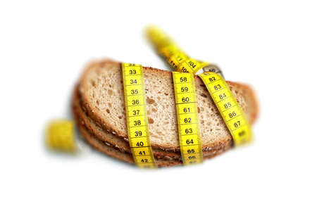 Brown slice of breads with measuring tape isolated on white Stock Photo