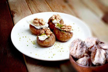 Walnut stuffed figs (Cevizli kuru incir tatlisi) is a type of Turkish dessert.