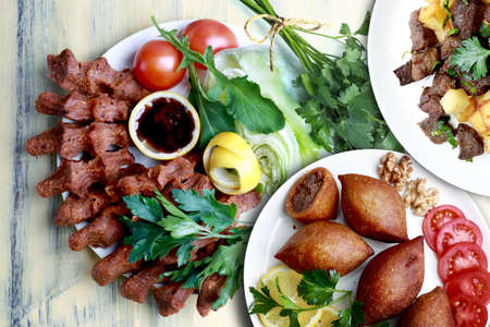 fried liver cubes, Kibbeh and cigkofte (In Turkish, cig means raw and kofte means meatball. It can also be written as one word, cıgkofte)