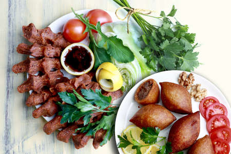 Kibbeh and In Turkish, cig means raw and kofte means meatball. It can also be written as one word, cıgkofte.