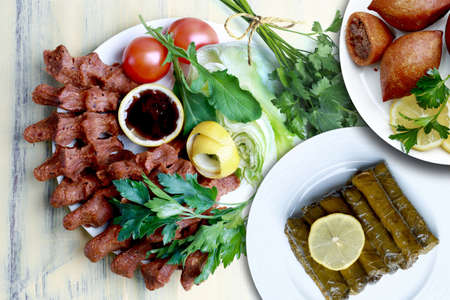 Kibbeh, stuffed vine leaves and In Turkish, cig means raw and kofte means meatball. It can also be written as one word, cıgkofte. Banco de Imagens