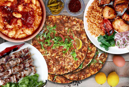 lamb on skewither, dry bean, chicken shish and Lahmacun. Traditional Turkish food Stock Photo