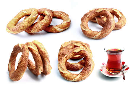 Fresh Turkish bagels and tea on a white background Banco de Imagens