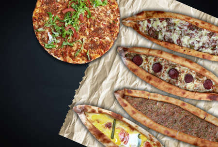Traditional Turkish pita varieties and Turkish pizza (lahmacun) on black background.