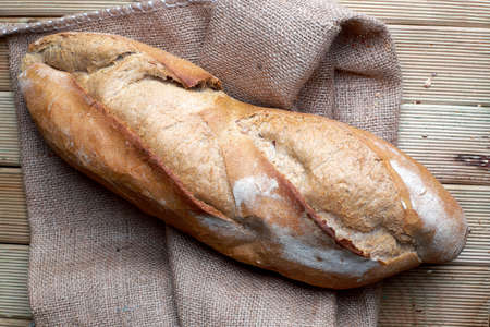 Fresh brown bread on the sack