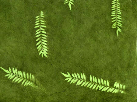 Vintage organic green forest leaves wallpaper background Stock Photo