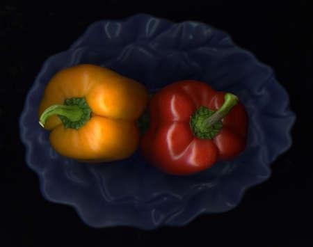 Fresh organic paprika and blue kitchen bowl