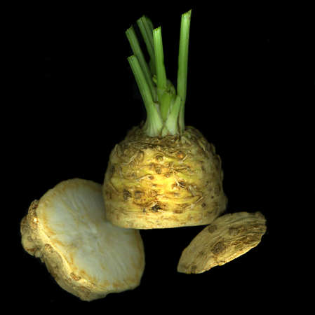 Organic fresh celery root isolated on black background