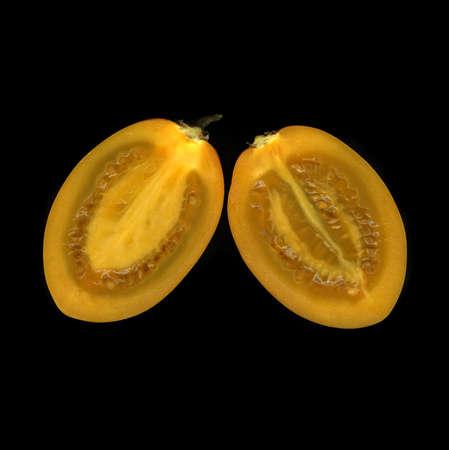 Organic fresh exotic fruit isolated on black background