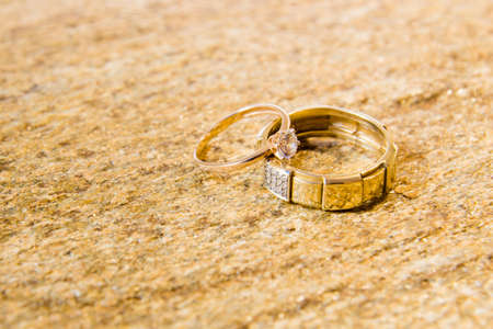 Wedding Rings On A Natural Stone With Inclusions Of Native Gold