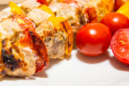Kebab with vegetables. Meat with tomatoes and peppers on bamboo skewers.