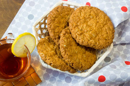Fresh oatmeal cookies. Delicious and healthy Breakfast. Invigorating hot tea with fresh lemon.