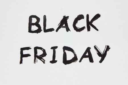 white sheet: The inscription on a white sheet of paper. Black Friday. A 50% discount. Sale. The inscription painted