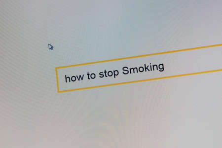 Photograph a computer display on which a person is looking to quit Smoking. Banco de Imagens - 87594792