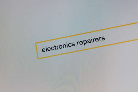 Photograph of a computer monitor where a person is looking for, how to call a repairman electronics.
