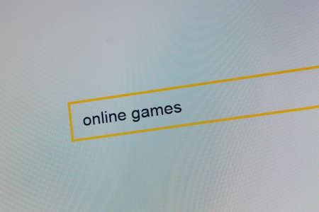 Photograph of a computer monitor where a person is looking for, new online games. Banco de Imagens - 87865188