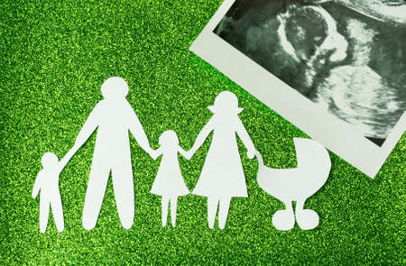 Paper image of happy families who are expecting another child.