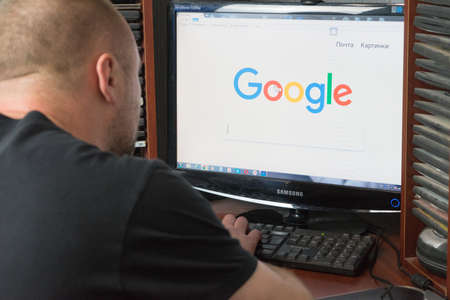 Belgorod, Russia - December 11, 2017: Man uses Google search. A white man sitting at the computer. Open the page Google ..
