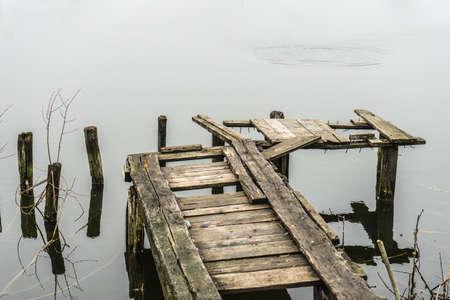 Old wooden bridge for fishing. The rotten bridge. Stock Photo