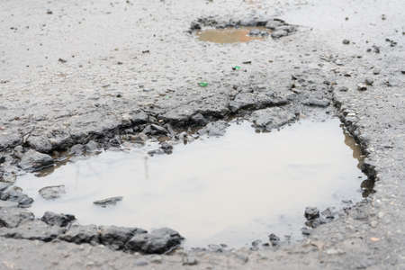 Potholes. Potholes dangerous to motorists and pedestrians.