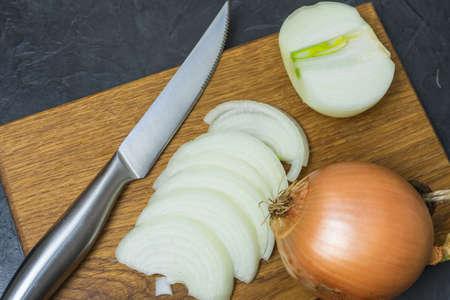 Cut onion on oak Board.