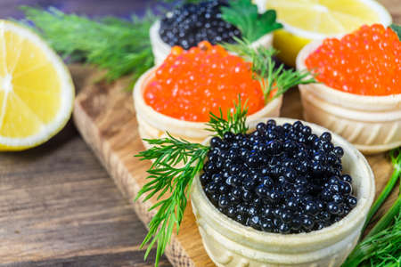 Festive sandwiches with red and black caviar. Healthy and tasty food. Stock Photo