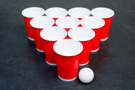 Beer pong. Popular game at parties. Place for your text.