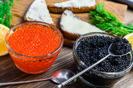 Festive sandwiches with red and black caviar. Healthy and tasty food. Archivio Fotografico