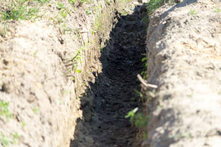 Dig a trench for construction. Place for your text. Stockfoto