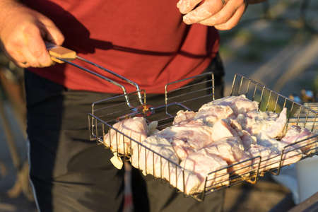 Preparing to roast meat on the coals. Stock Photo