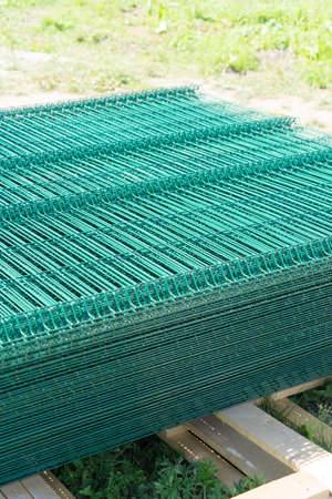 Material for the construction of a mesh fence. Stock Photo