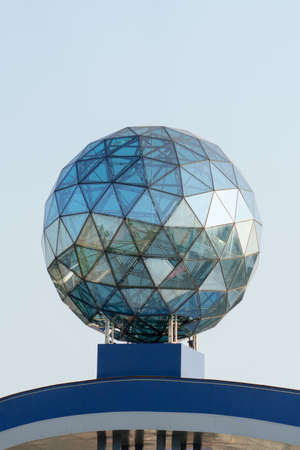 Large glass ball on the roof of the building. Stock Photo