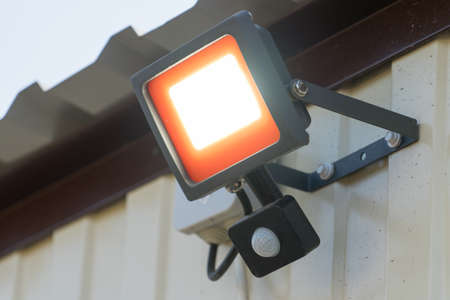 Led spotlight with motion sensor. Place for your text..