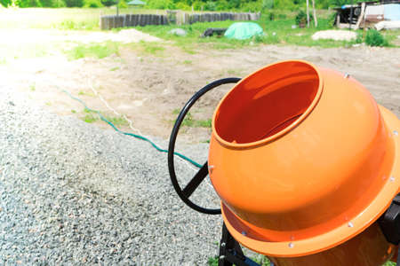 Photo concrete mixer installed on the construction site. Stock Photo