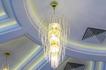 Crystal chandelier hanging from the ceiling. Place for your text..