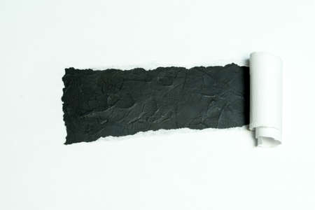 A sheet of white paper torn in the middle. a piece of paper wrapped.. Banco de Imagens - 119883155