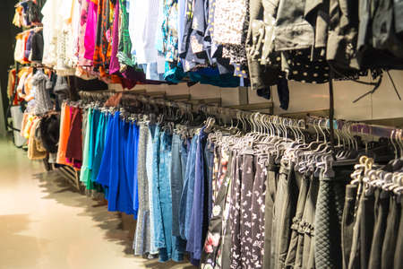 Womens clothing in the store. colorful womens clothing