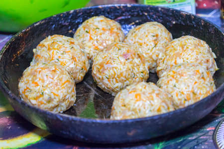 Sculpt meat meatballs with rice, carrots and herbs Banco de Imagens