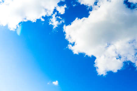 Photo of a blue Sunny sky with white clouds. Photo of a blue Sunny sky with white clouds. Banco de Imagens - 119883103