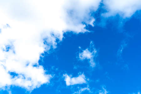 Photo of a blue Sunny sky with white clouds. Photo of a blue Sunny sky with white clouds.