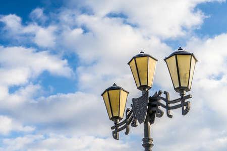Street lamp. Photo against the blue sky. Street lamp. Photo against the blue sky. Banco de Imagens