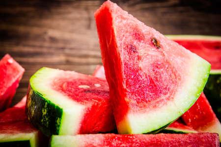 Cut watermelon. Juicy and fresh watermelon. Place for your text. Cut watermelon. Juicy and fresh watermelon. Place for your text. Banco de Imagens