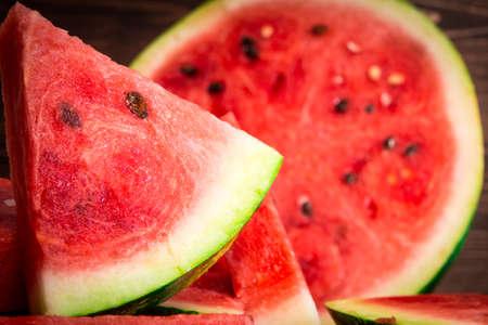 Cut watermelon. Juicy and fresh watermelon. Place for your text. Cut watermelon. Juicy and fresh watermelon. Place for your text. Banco de Imagens - 119882634