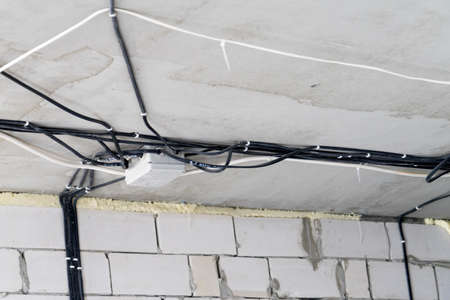 Manufacture of electrical wiring in a brick house. Manufacture of electrical wiring in a brick house. Banco de Imagens