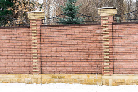 The fence is built of brick. Place for your text. The fence is built of brick. Place for your text.