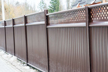 Fence. Metal fence private territory. The fence is brown. Fence. Metal fence private territory. The fence is brown. Banco de Imagens