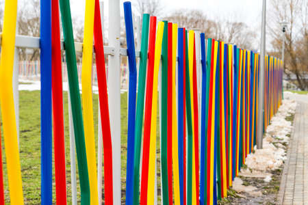 colorful fence. Fence made of metal painted in different colors. ccolorful fence. Fence made of metal painted in different colors.