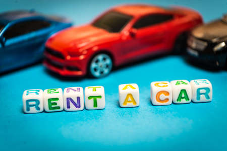Photo toy cars. The inscription to rent a car. Photo toy cars. The inscription to rent a car. Banco de Imagens