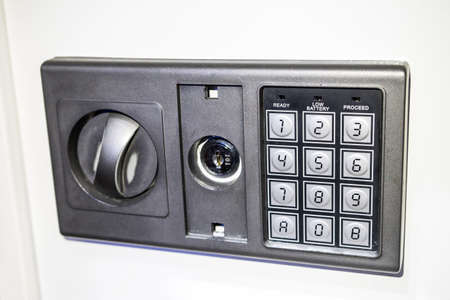 Photo of the front panel of the safe with an electronic code set. Photo of the front panel of the safe with an electronic code set.