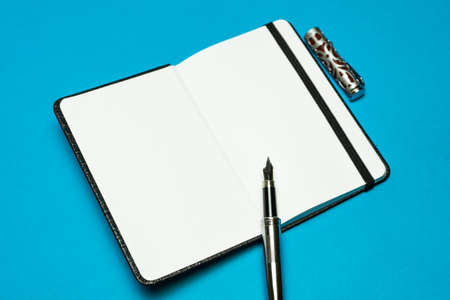 The blank notebook is open and ready for writing. The blank notebook is open and ready for writing.